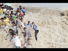 Enjoyment of tidal bore in Qiantang jiang River Mid autumn Holiday 2013 September - YouTube