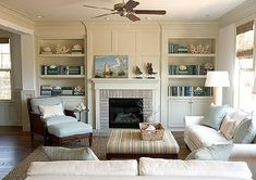 lovely molding at top of built ins, brick fireplace surround