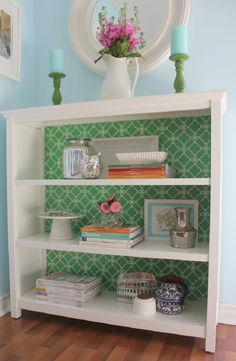 Do this with short white bookshelf.  Put plywood on back and cover with paper
