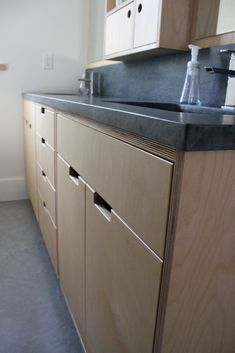 Plywood bathroom cabinets.  Detail of drawers & soapstone counter & splashback.
