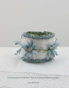 Hello, stitching world ♬❤♬  This gorgeous piece is from our new book, The Art of Felting and Silk Ribbon Embroidery.