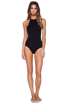 Shop for Marysia Swim Mott One Piece Swimsuit in Black at REVOLVE. Free day shipping and returns, 30 day price match guarantee. High Neck Swimwear, One Piece Swimwear, Standing Poses, India, Revolve Clothing, Triangle Bikini, Bodysuit, Swimsuits, Athletic Wear