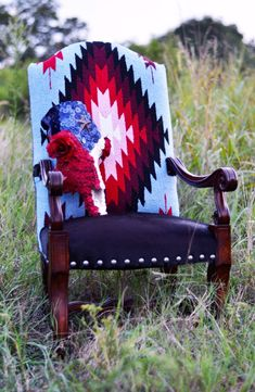 Tall accent arm chair dressed in Bright red, pink, blue & white vintage Saltillo blanket and premium hair on hide black cowhide on seat & backside of chair embellished with large silver nail heads. Log Cabin Furniture, Western Furniture, Rustic Furniture, Furniture Design, Mexican Furniture, Italian Furniture, Garden Furniture, Furniture Ideas, Southwest Decor