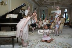 Stock Photo : Girl (6-8) bowing by piano at party
