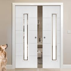 Double Pocket Dominion White sliding door system in three size widths with Etched Clear Glass. #whitepocketdoor #whiteglazedpocketdoors #modernpocketdoors