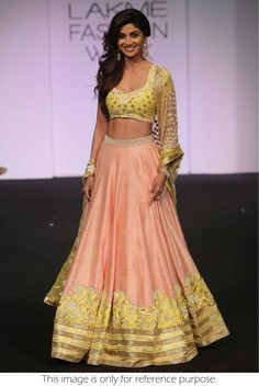 Bollywood Shilpa Shetty Raw Silk Party Wear Lehenga Choli in Peach and Yellow Colour.It comes with matching Dupatta and Bottom.It is crafted with Zari Work,Embroidery,Lace Work Design.This product can...