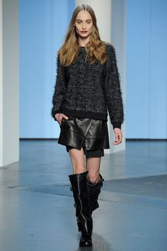 Boots! More wearable than fashion forward but the layers and scruffy sweater plus buckled tall shaft shiny calf boots make a strong fall statement.  Tibi Collection Slideshow on Style.com