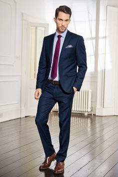 blue suit that color, the deep reddish brown accents in the shoes