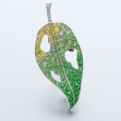 A platinum, sapphire, demantoid garnet and diamond leaf brooch by Gimel, Japan.