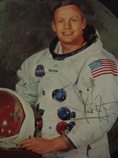 NEIL ARMSTRONG Autographed 8 x 10 Color Photograph Print: 1st Man to Walk on the Moon, in Astronaut Flight Suit. Autograph slightly Smeared, From Estate of NASA Public Affairs Officer. One of Most Sought after Autographs on the market today. (1500-3000)