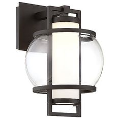 The brilliant, symmetrically designed Lucid LED Outdoor Wall Sconce by Modern Forms features a solid aluminum frame that holds a spherical, mouth-blown clear outer glass shade and an inner etched opal glass core. High-powered, dimmable LED's radiate from the center, permeating through both shades for a warm, even display. Ideal for outdoor walls, walkways, and patio areas.