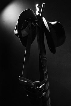 Coat rack with fedoras and a gun; Detective Aesthetic, Detective Agency, Film Noir Photography, Spy Who Loved Me, Fiction, Black And White Comics, Hades And Persephone, The Villain, Dieselpunk