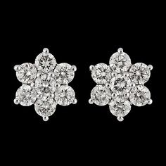 Yummy! A pair of brilliant cut diamond earrings, tot. 1.07 cts. 18k white gold. Quality app. H/VS-SI