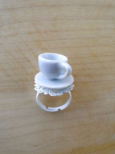 This ring features a miniature tea cup and saucer on an adjustable ring, also white. White filigree on ring looks like a delicate doily. Cup And Saucer, Jewerly, Tea Cups, Delicate, Silver Rings, Miniatures, Tableware, Pendants, Jewelry