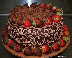 Chocolate Cake with Chocolate-coated Strawberries and Chopped Chocolates - this looks like one of those cakes you'd be drooling over...