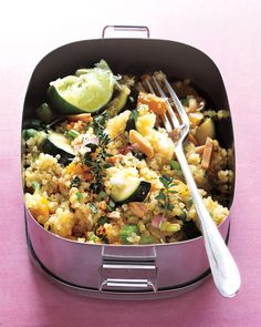 Quinoa has a wonderful nutty flavor; here it is blended in a salad with toasted almonds, bell pepper, zucchini, celery, and a lime is squeezed on top.