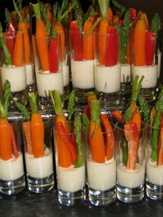 Encourage little ones to eat their veggies with a fun presentation for a healthy snack. Using plastic or lucite shot glasses, serve individual servings of veggies and dip. To make these healthy a. Veggie Dip Cups, Veggie Tray, Vegetable Dips, Vegetable Platters, Veggie Display, Vegetable Sticks, Tapas, Brunch, Cooking Recipes