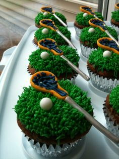 Lacrosse Cupcakes - My first attempt at making Lacrosse Cupcakes... the sticks and balls are all made of fondant and the net I piped with icing.