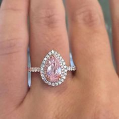 Diamond Jewelry Pink Pear Shaped Diamond Engagement Ring - Everything looks better in pink – especially diamonds. No diamond sparks excitement and admiration like the pink diamond. As the creme de la creme of gems, it bestows an aura of wealth, luxur… Pink Diamond Ring, Pear Shaped Diamond, Diamond Wedding Rings, Halo Diamond, Diamond Cuts, Pink Diamond Engagement Ring, Halo 3, Wedding Bands, Pear Diamond