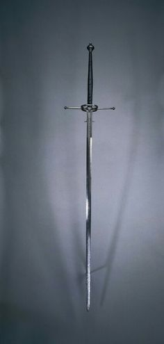 Two-Handed Sword, 1550-1600 Spain, Toledo (?), second half of 16th Century steel, wood and leather grip, Overall: l. 167.30 cm (65 13/16 inches); Blade: l. 126.00 cm (49 9/16 inches); Quillions: w. 31.80 cm (12 1/2 inches); Grip: l. 40.00 cm (15 11/16 inches); Ricasso: w. 17.20 cm (6 3/4 inches). Gift of Mr. and Mrs. John L. Severance 1916.1507
