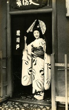 "Maiko Hisagiku in a Doorway (1939)    ""Hisagiku standing in the doorway of an Ochaya (Tea-house) japan"