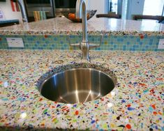Recycled glass countertops. I love how colorful this is! Would be great in a green kitchen