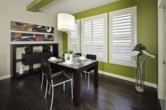Dining Room - Punches of colour and dark stained hardwood floor give this room a modern feel