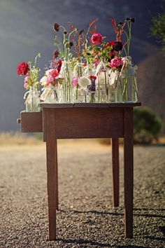Love the simplistic beauty of wildflowers in random sized glass vases