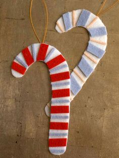 Use felt to construct these festive candy cane ornaments! Feel free to  alternate colors to coordinate with your holiday décor.