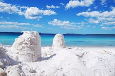 WHITE    Hyams Beach is a village located in New South Wales, Australia and surrounded by three brilliantly white sand beaches. Hyams Beach is present in the Guinness Book of Records as having the beaches with the whitest sand in the worl