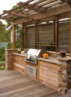 Outdoor Kitchens Built In Grill Design- like the location of girll & privacy. May do different wood/stone though.Built In Grill Design- like the location of girll & privacy. May do different wood/stone though. Rustic Outdoor Kitchens, Backyard Kitchen, Outdoor Kitchen Design, Backyard Patio, Patio Bar, Backyard Storage, Outdoor Bbq Kitchen, Outdoor Cooking Area, Rustic Patio