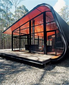 This futuristic pod-like home was designed by Judd Lysenko Architects in Melbourne, Australia. The bright orange stain on the curved plywood interior wall makes the house glow like a giant ember in the night.