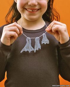 Glue Ghoulery! Make your own spooky ghost necklace using Elmer's School Glue, string, and a felt-tip pen (or a permanent marker). An easy and fun activity for kids.