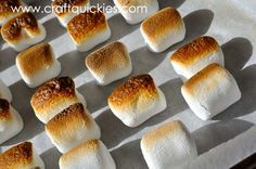 Line a cookie sheet with parchment paper and set your oven to broil.  Move your oven shelf to the top setting so that your marshmallows can ...