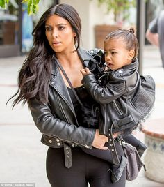 Married! Kim Kardashian recycles her matching leather jacket from her May 24 nupitals to Kanye West as she picks up daughter Nori from ballet class in LA on Thursday