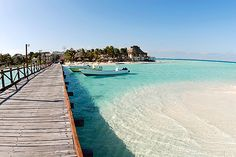 Isla Mujeres (Island of Women) off the coast of Mexico, near Cancun. A laid back island with a Mayan temple dedicated to the Goddess of Fertility. Marine park, sea turtle habitat, diving with whale sharks and close to the Cave of Seeping Sharks.