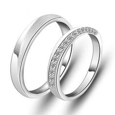 A perfect combination pair of Sterling Silver Cubic Zirconia His and Hers Matching Wedding Bands. The satin finish wedding band is for him and the wedding band with cubic zirconia stones is for her.