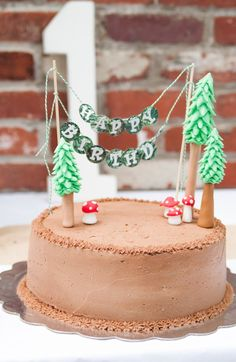 Love the cake! Woodland Animal 1st birthday party with SUCH SWEET IDEAS via Kara's Party Ideas | Cakes, favors, games, printables, and more! KarasPartyIdeas.com