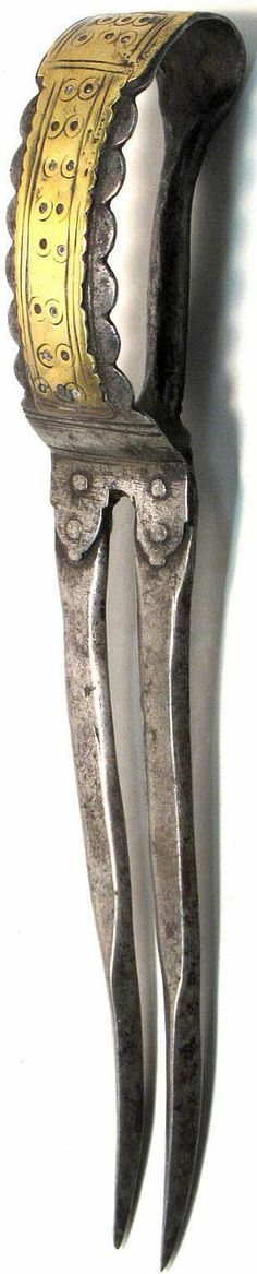 Indian bichwa dagger, 19th century, two 6 inch recurved blades with thickened points, narrow grip and broad guard overlaid with a brass plate.