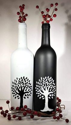 crafts black Black and white trees hand painted on wine bottles reflect the beauty and simplicity of nature. Painted Glass Bottles, Glass Bottle Crafts, Wine Bottle Art, Diy Bottle, Decorated Bottles, Pottery Painting Designs, Glass Painting Designs, Bottle Centerpieces, Wine Bottle Decorations