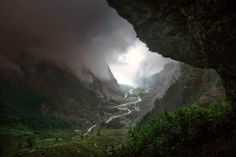 "Descent to Rivendell by Enrico Fossati. ""During a violent thunderstorm in the High Savoy valley, Enrico found refuge inside a big cave in the mountain. From the inside of the cave he had the chance to capture and admire a dangerous and fascinating summer storm. The quick movement of the clouds gave him only few chances to capture the scene in good conditions."""