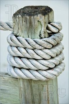 Photo of Nautical rope winding on wooden stake-for our deck.