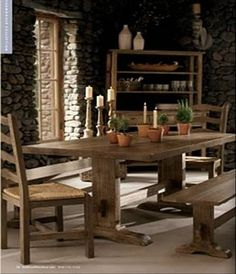 Love the stone wall.. and also the table and open shelving.