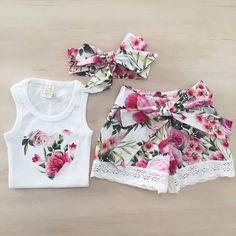 Our matching Lilly set is the perfect summer outfit for your girly girl! Decorated in colorful florals, she'll be ready to tackle any day in charming fashion. Includes:tank top, shorts, headband Closure:Pullover