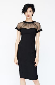 The sheer gathered neckline on this black sheath dress is gorgeous.