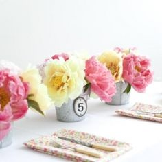 Centerpieces inspired by French Flower Markets {image via Once Wed}