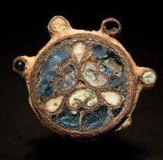 Cloisonné Brooch       ca. late 10th - 11th century AD       England       width:  2.6 cm