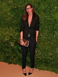 : Another shot proves that she loves the look of a masculine suit made sexy with a deep V-neck top.