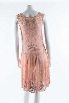 A beaded pink muslin flapper dress, circa 1928. Back