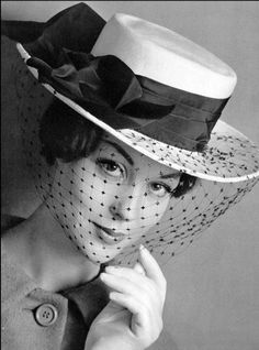 1959 Model is wearing white gros-grain boater with black taffeta band and sheer voilette by Albouy, photo by Philippe Pottier